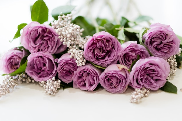 Beautiful flower arrangement for a special occasion. pink roses on white background. floral gift on mother's day or march 8