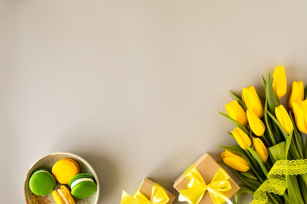 Beautiful flower arrangement. yellow flowers tulips, empty frame for text on a white background. wedding. birthday valentine's day. mothers day. flat lay, top view, copy space