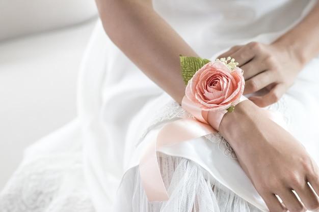 Beautiful flower bracelet on bridesmaid's hands.