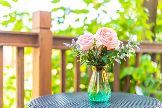 Beautiful flower in vase on table decoration with garden view