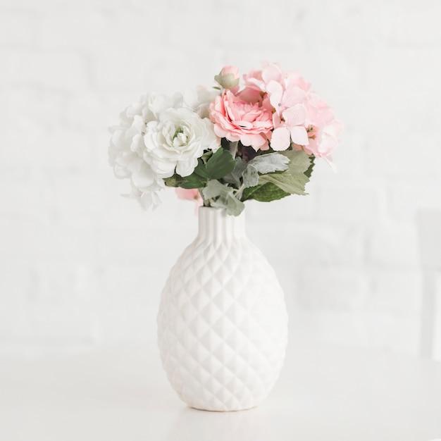 Beautiful Flowering Vase On White Table
