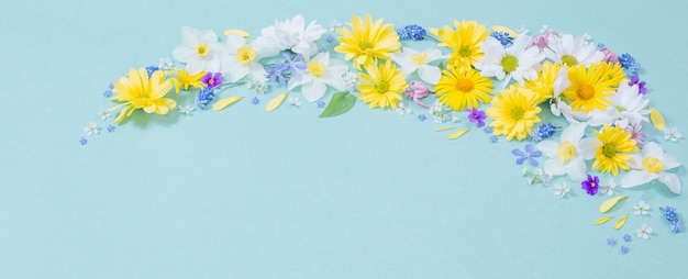 Beautiful flowers  on blue paper wall