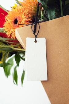 Beautiful flowers in a shopping bag