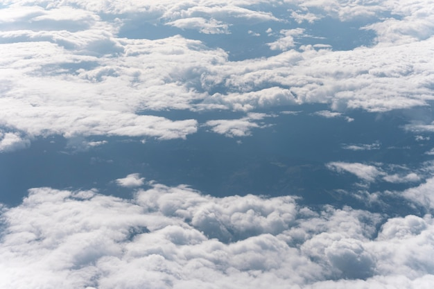 Beautiful fluffy clouds seen from airplane