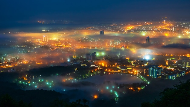 Beautiful fog over the city at night