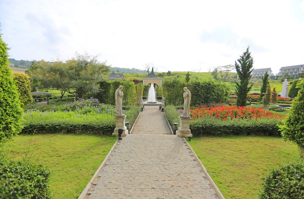 Beautiful fountain in the flower garden.