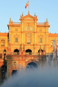 Beautiful fountain in front of the main entrance of plaza de espana in seville