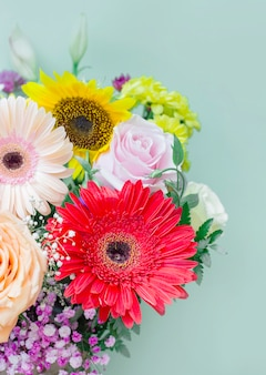 Beautiful fresh bouquet of flowers on colored background