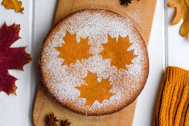 Beautiful fresh sweet pumpkin cake with a maple leaf pattern
