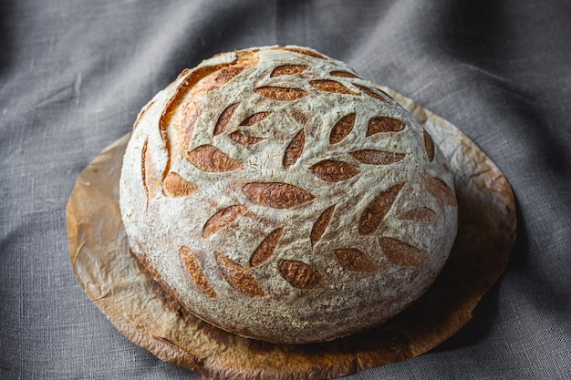Beautiful, freshly baked natural sourdough bread. homemade bread with decorative notches