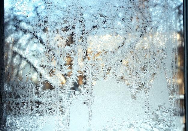 Beautiful frosty on window glass in winter