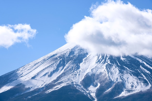 Beautiful fuji mountain top view with snow and clouds covered over blue sky winter, japan