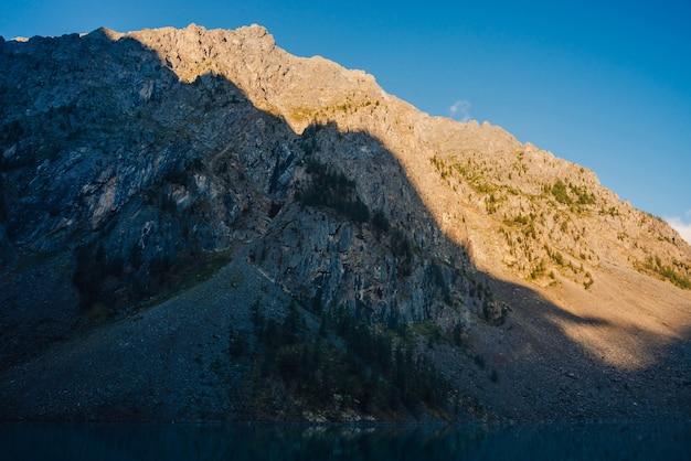 Beautiful giant rocky ridge in sunlight