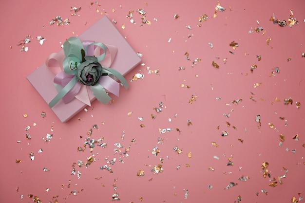 Beautiful gift box on festive pink