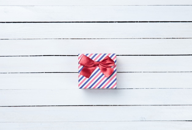 Beautiful gift box presents on white wooden background
