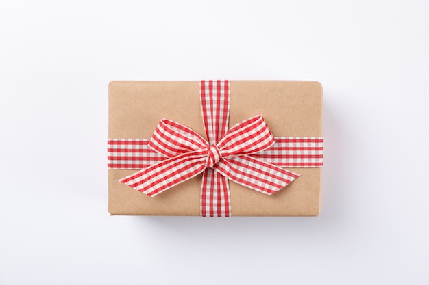 Beautiful gift box with bow on white background, space for text