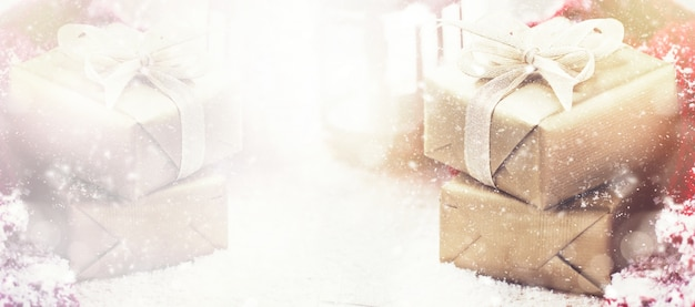 Beautiful gift boxes with christmas props on pastel background