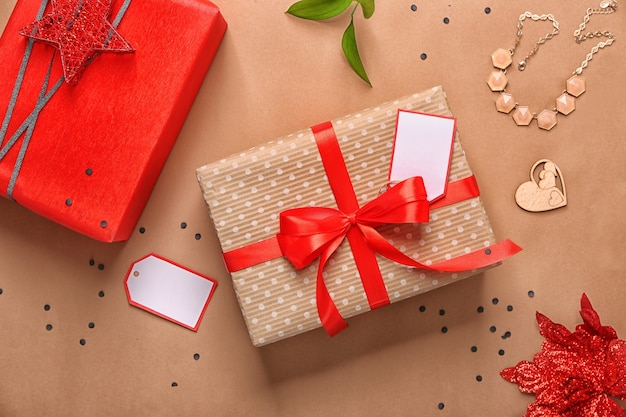 Beautiful gift boxes with decor on color background. flat lay composition