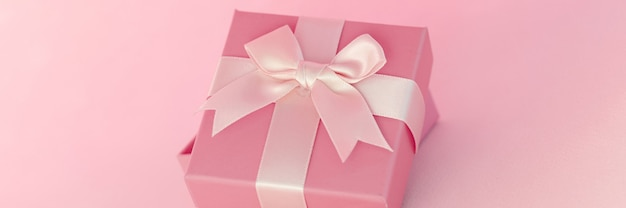 Beautiful gift with bow standing on blue background gift wrapping concept
