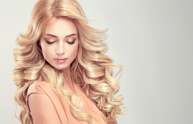 Beautiful girl blonde hair with an elegant hairstyle