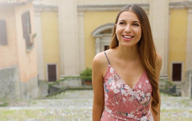 Beautiful girl climbs street in old italian town. copy space area.
