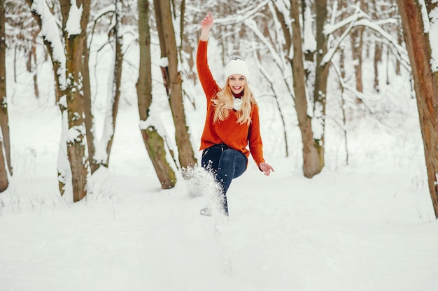 Beautiful girl in a cute orange sweater