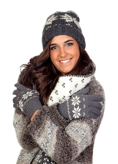 Beautiful girl dressed in winter clothing isolated on a over white