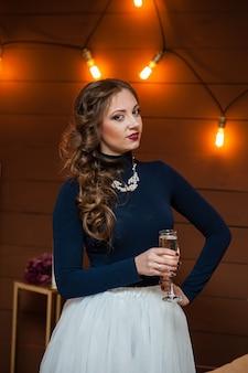 Beautiful girl drinking champagne