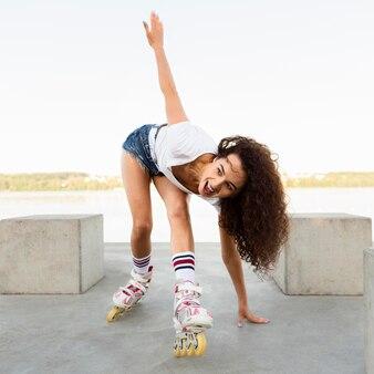 Beautiful girl enjoying her walk in rollerblades
