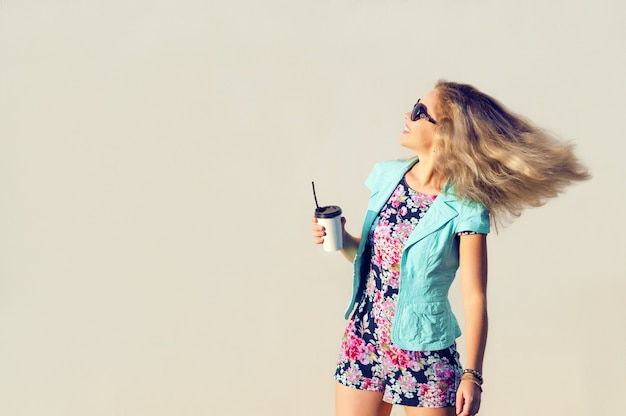 Beautiful girl in fashionable clothes, glass in hand