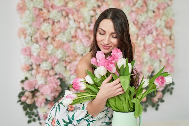 Beautiful girl on floral background.