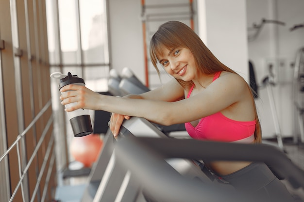 A beautiful girl in a gym on a racetrack