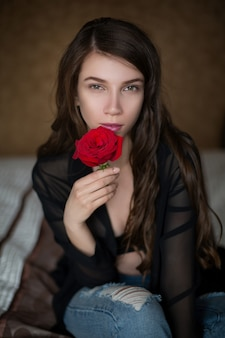 Beautiful girl holding a rose flower