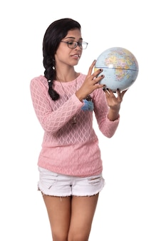 Beautiful girl holding a world globe isolated