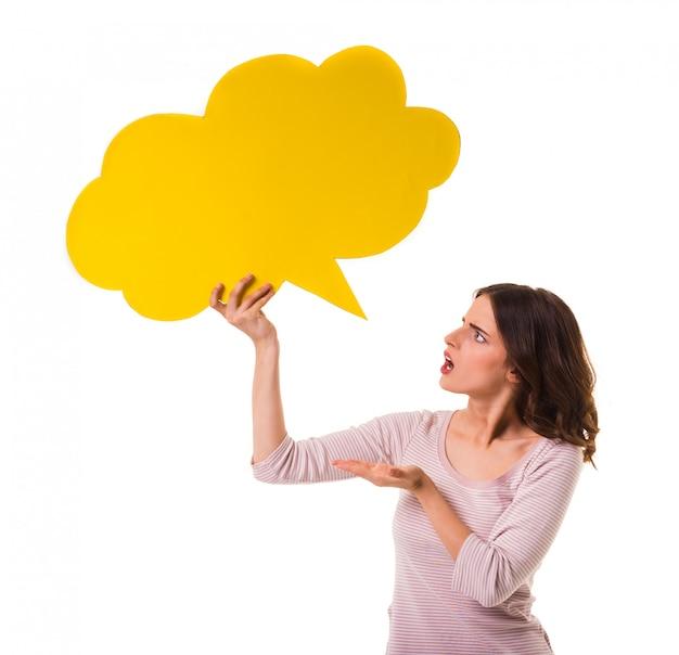 Beautiful girl holding a yellow speech bubble
