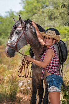 Beautiful girl and horse in nature