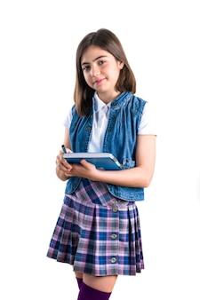 白の手にノートを持った制服姿の美少女
