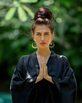 Beautiful girl is engaged in meditation
