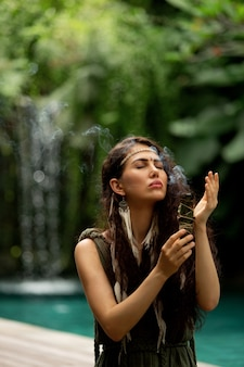 A beautiful girl is engaged in shamanic practices