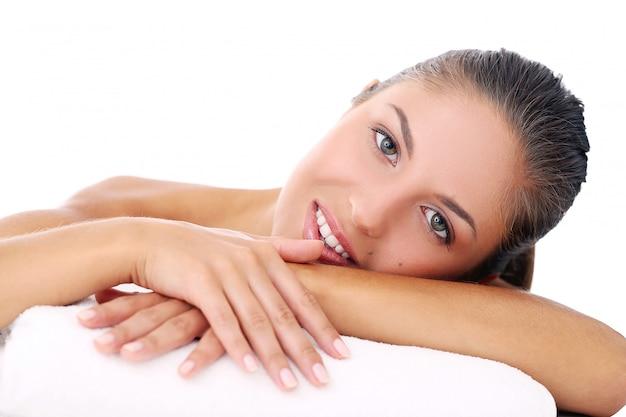 Beautiful girl lying on her arm