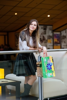 Beautiful girl makes a purchase at the mall.