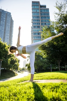 Beautiful girl making morning yoga training in new york