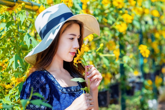 Beautiful girl and mexican sunflower.