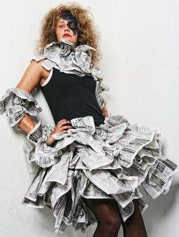 Beautiful girl in a newspaper dress