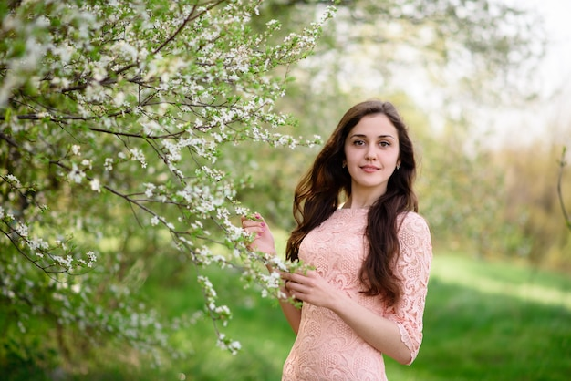 Beautiful girl outdoors in the spring.