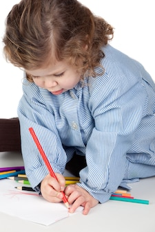 Beautiful girl painting with preschool uniform on a white background isolated