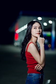 Beautiful girl photo shoot like in the red dress at night