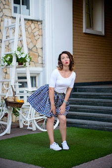 The beautiful girl in pin-up style