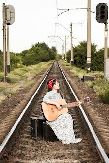 A beautiful girl plays the guitar