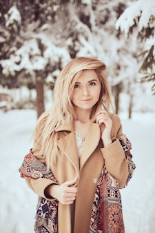 Beautiful girl portrait on the winter park